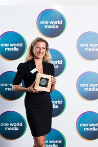 Juliana receiving One World Media award.